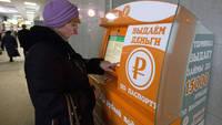 Rusii au inventat bancomatul care-ti da bani pe datorie